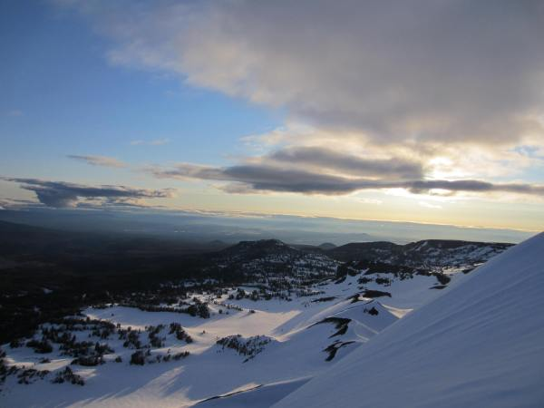 Looking East Towards Bend Oregon at Dawn from Broken Top NW Ridge Picture Taken by Joel Bornzin