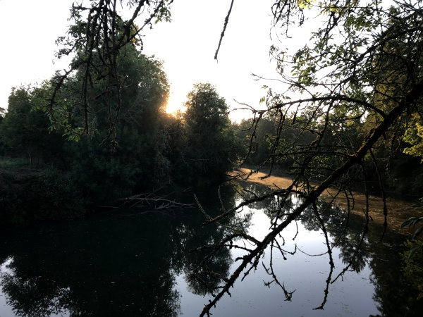 Sun breaks over the Tualatin River